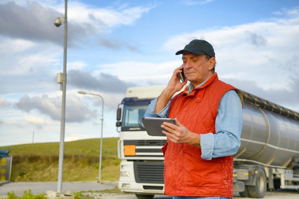 Truck driver looking at his tablet