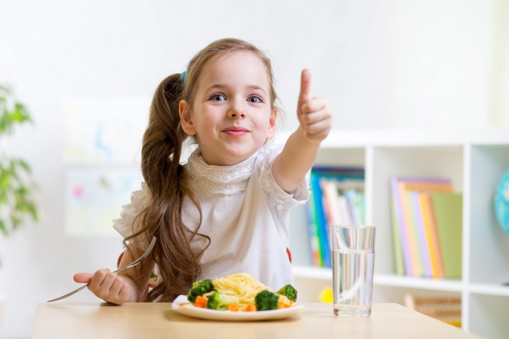 Little girl eating a healthy meal