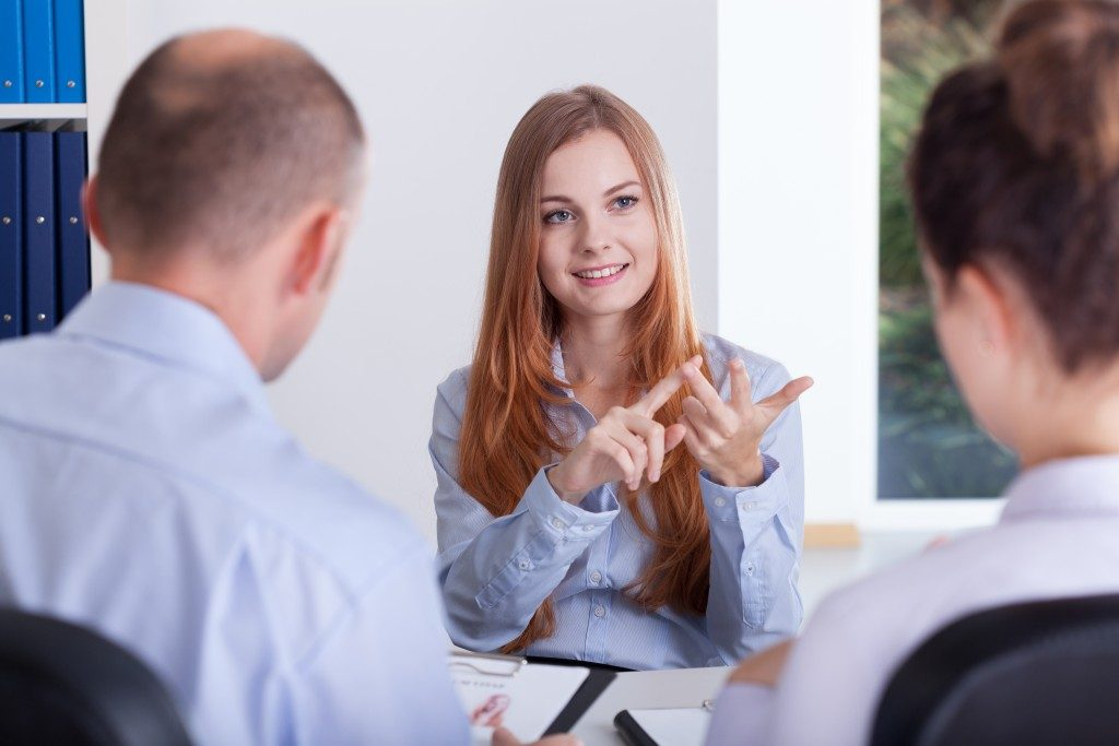 Confident woman being interviewed for work