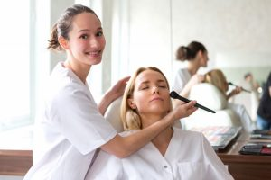 Makeup artist putting on foundation