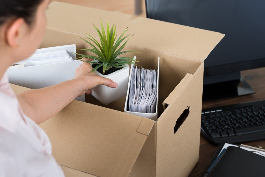 Resigned employee packing her office things