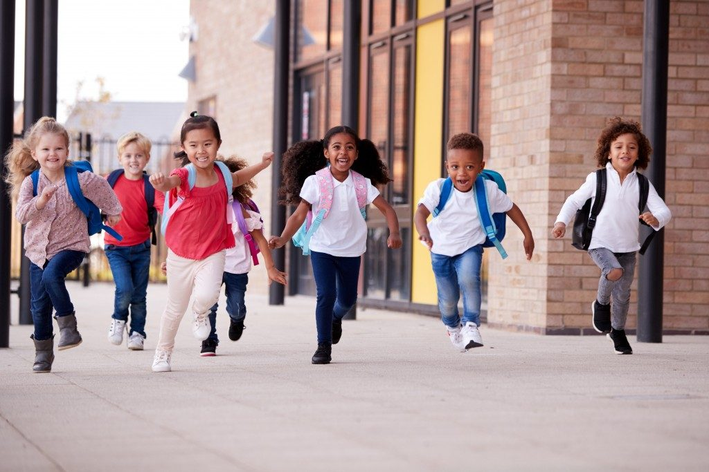 children happily running in their school