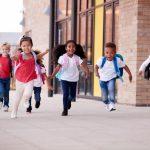 children happily running in their school
