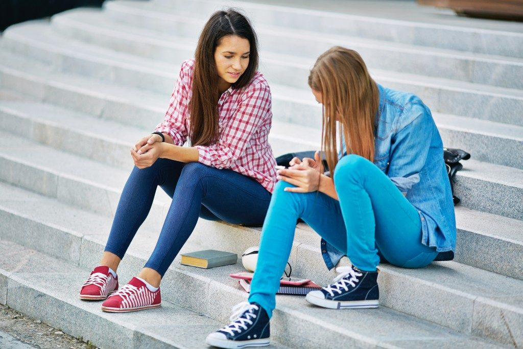 teens talking by the steps