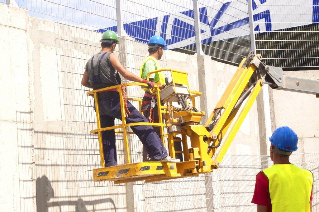 men on a construction platform