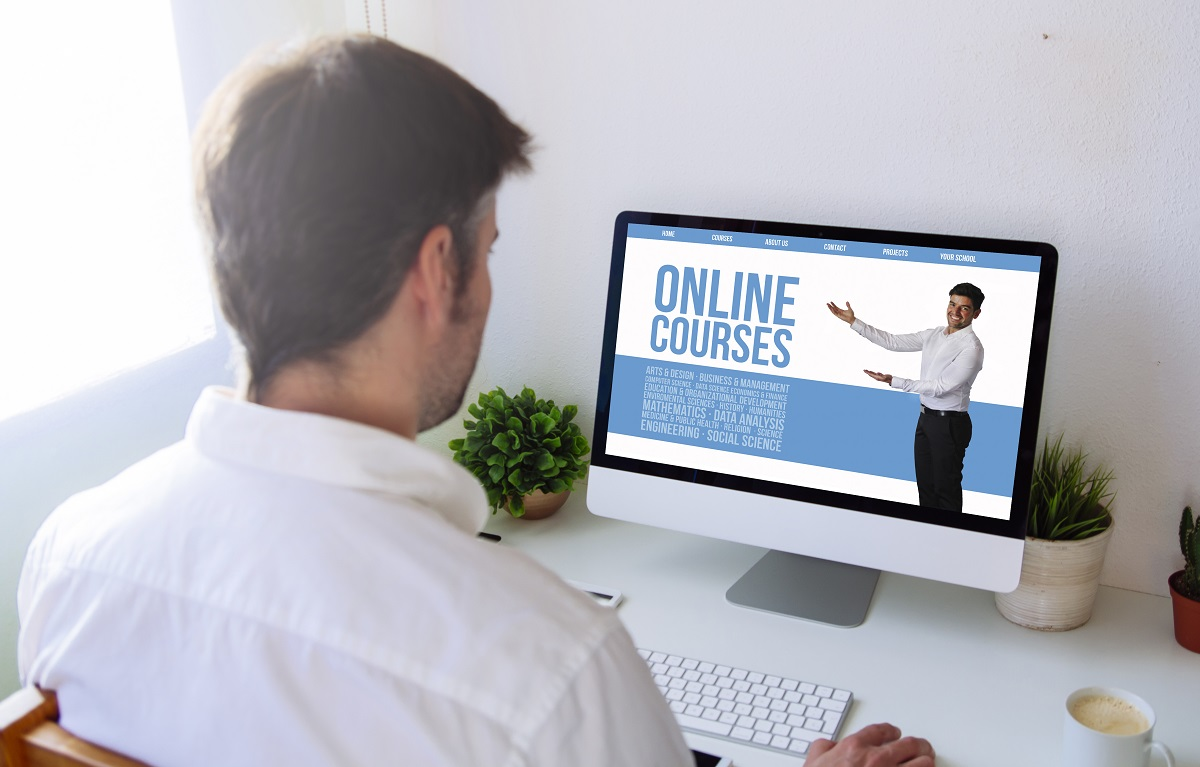 man taking online course