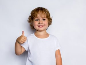 happy child giving thumbs-up