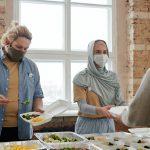 volunteers at a feeding program